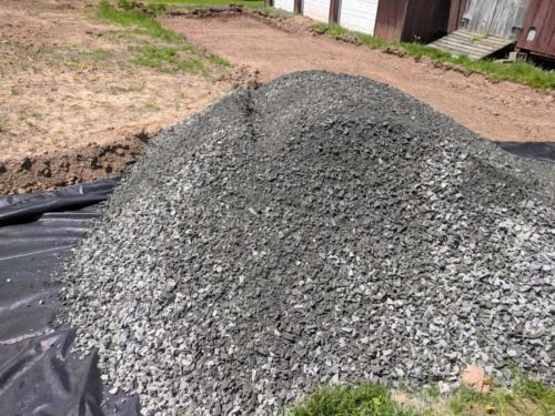 Gravel pile on the new driveway area